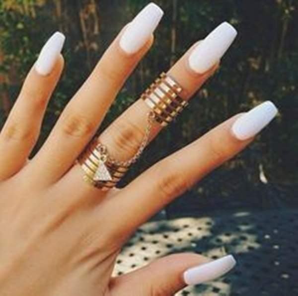 For your long nails, shape them into a square shape, paint them a bold white.  Finish the look with stylish rings. A simple acrylic nail design ... - 61 Acrylic Nails Designs For Summer 2018 - Style Easily