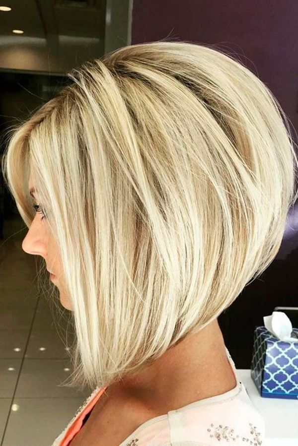 Beautiful deep blonde hair color gives this stacked bob hairstyle the chic that cannot be matched by any other hairdo.
